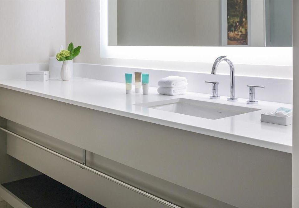 bathroom sink mirror counter countertop long plumbing fixture bathtub cabinetry bathroom cabinet Kitchen flooring bidet shelf clean