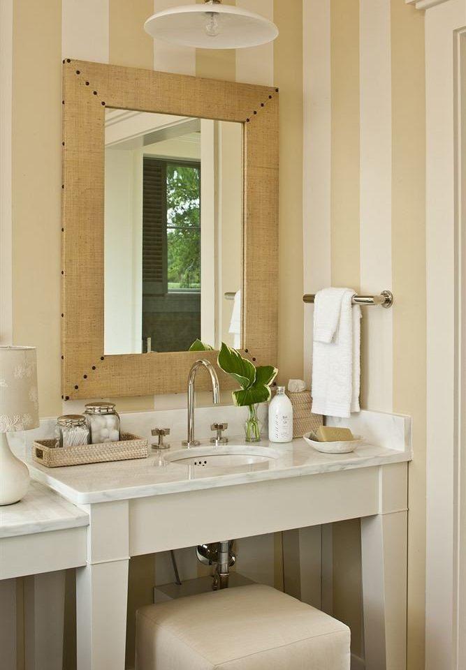 bathroom mirror sink property home cabinetry lighting Kitchen cottage plumbing fixture bathroom cabinet tan
