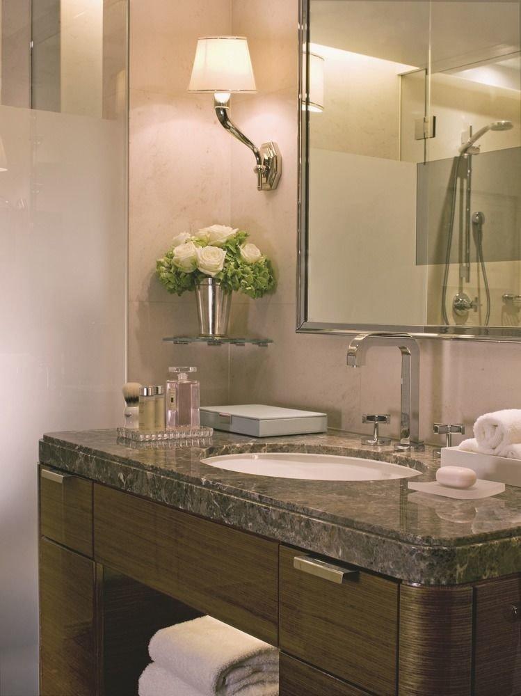 bathroom sink mirror countertop cabinetry lighting plumbing fixture towel tile bathroom cabinet flooring Kitchen