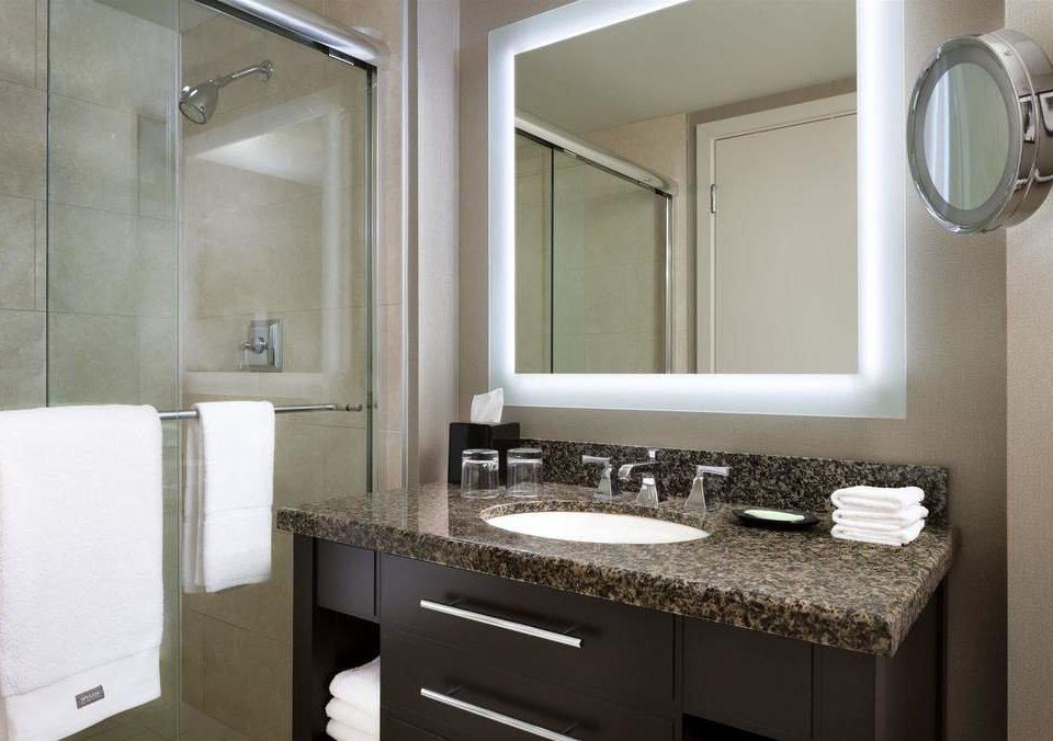 bathroom mirror sink property towel home countertop vanity Kitchen shower bathroom cabinet cabinetry cottage clean toilet stall rack tan