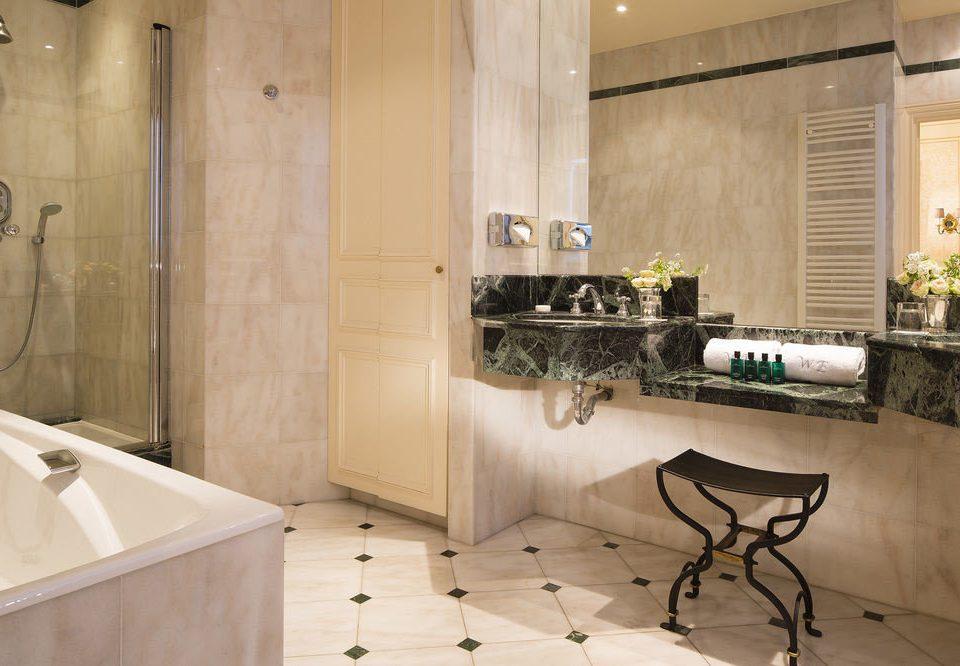 bathroom property countertop cabinetry home flooring Kitchen tile bathtub wood flooring plumbing fixture