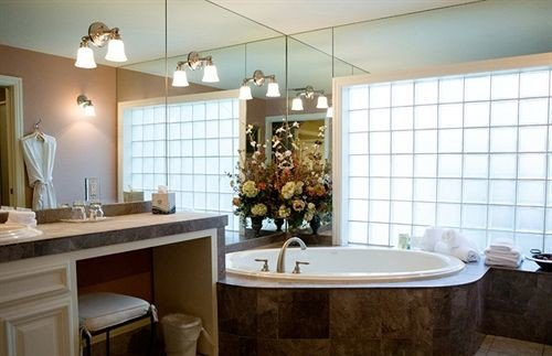 property bathroom countertop home Kitchen sink cabinetry cottage flooring tub bathtub