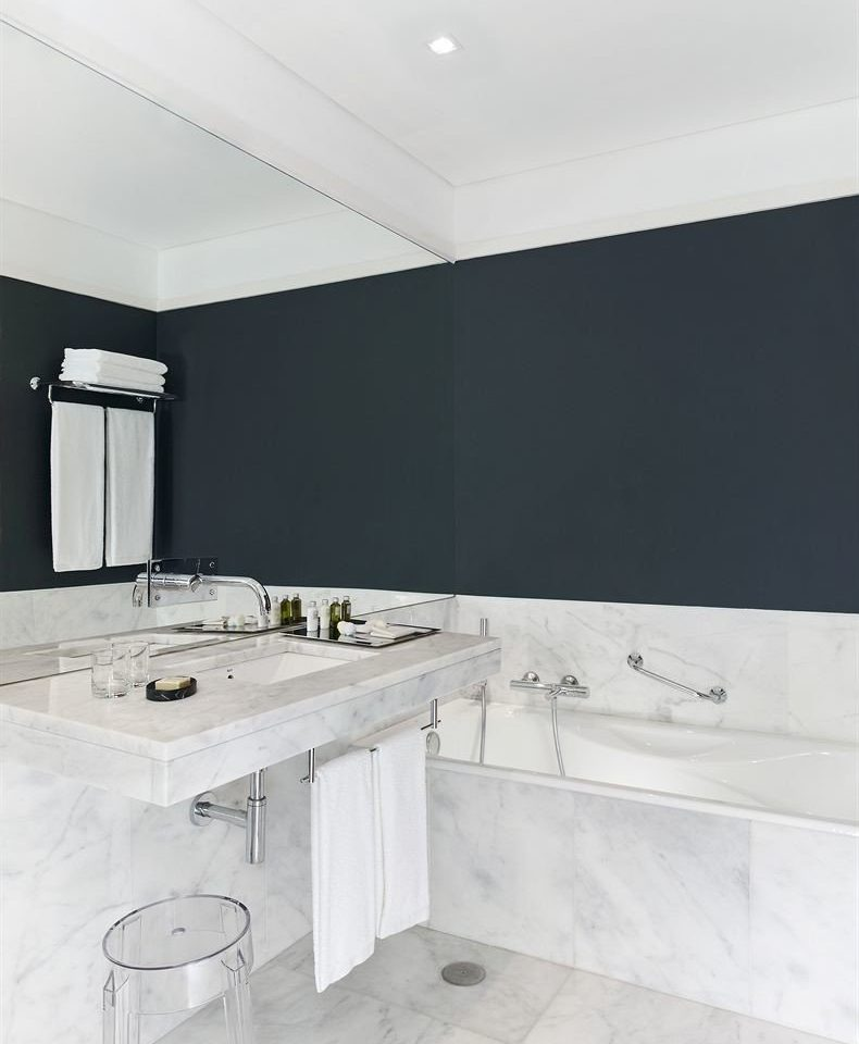 bathroom white property countertop Kitchen sink tile flooring toilet plumbing fixture bathtub material