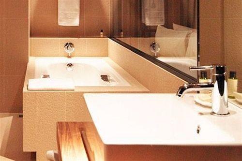 bathroom sink countertop plumbing fixture toilet hardwood bathtub flooring swimming pool material Kitchen