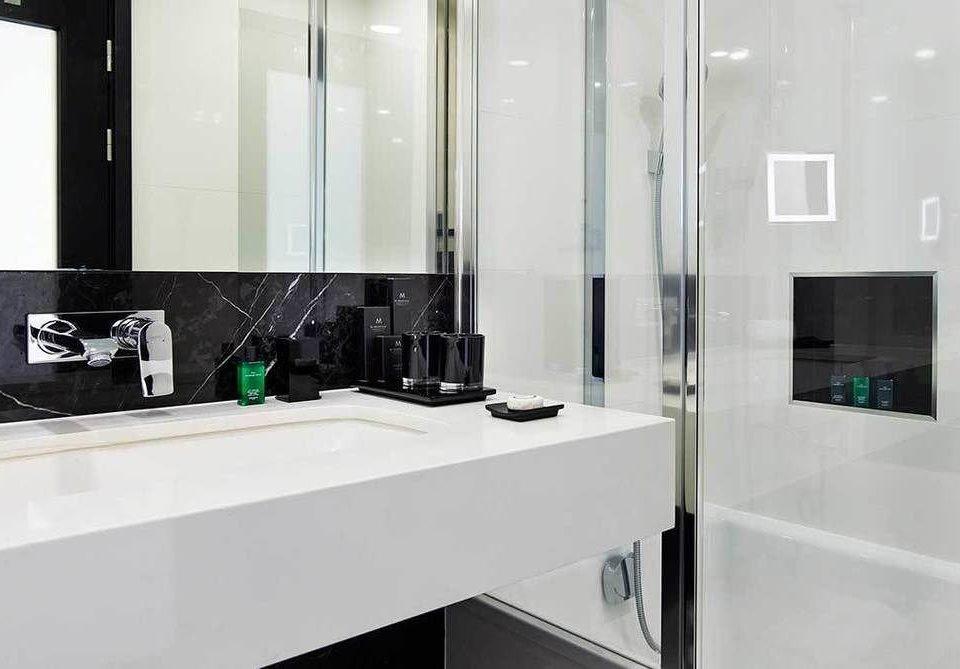 bathroom property countertop plumbing fixture sink glass flooring bathtub material tile toilet Kitchen
