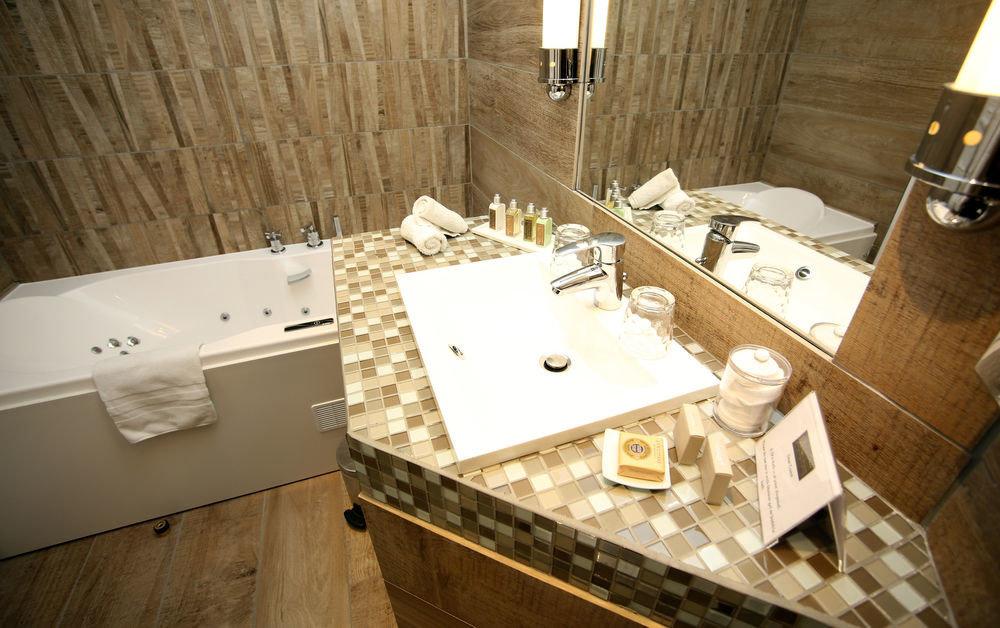 bathroom countertop sink plumbing fixture home flooring bathtub Kitchen tile