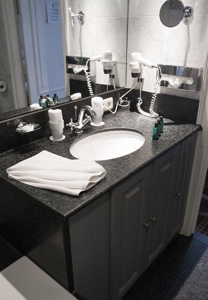 bathroom sink plumbing fixture countertop home swimming pool bidet Kitchen flooring jacuzzi toilet
