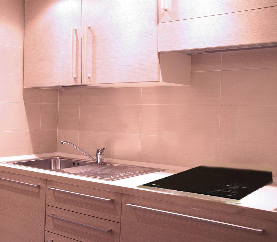 cabinet Kitchen countertop stove bathroom sink cabinetry plumbing fixture tile flooring