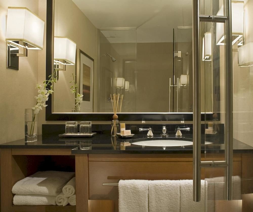 bathroom mirror property sink cabinetry lighting home Kitchen condominium living room towel cabinet