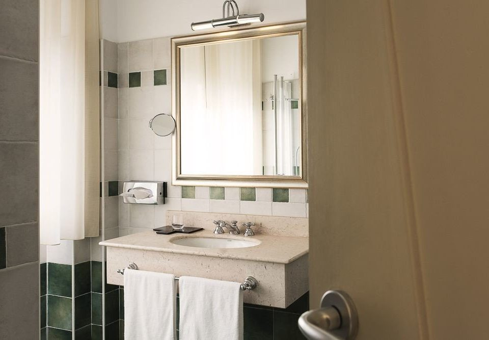 bathroom mirror sink property countertop Kitchen home cabinetry cottage toilet tile tiled