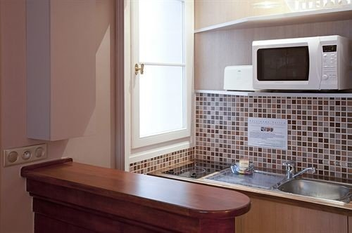 property Kitchen countertop home hardwood cottage cabinetry bathroom flooring microwave kitchen appliance