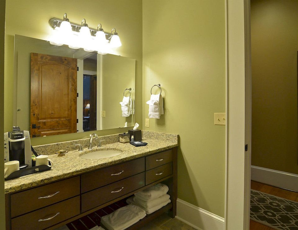 bathroom property sink mirror home cabinetry house Kitchen countertop cottage