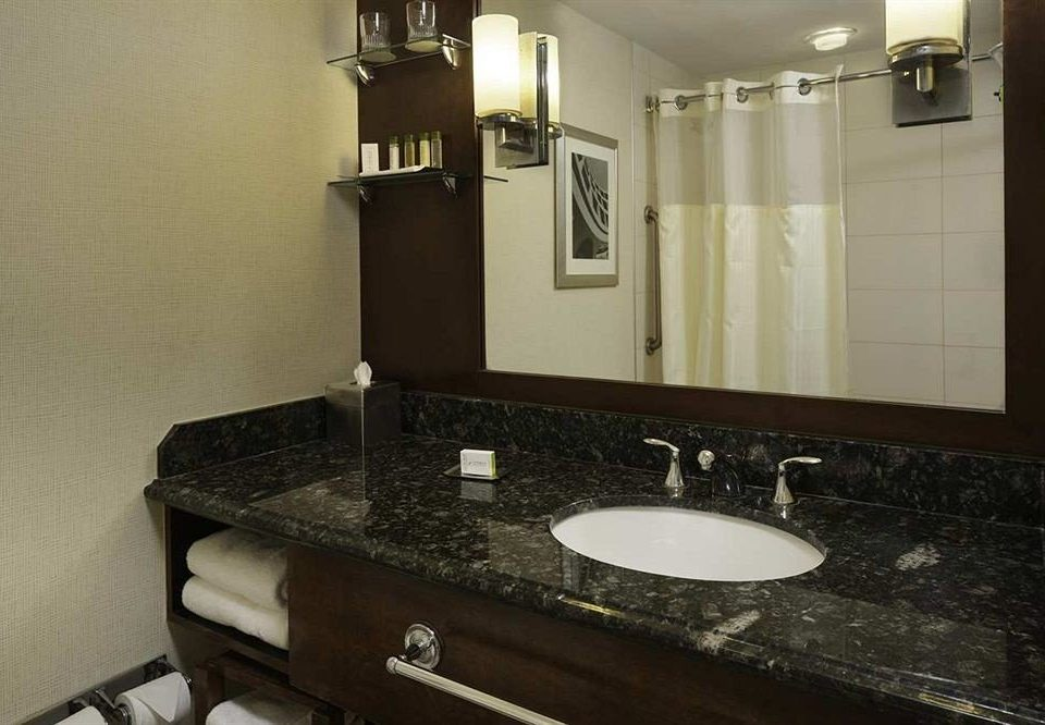 bathroom mirror sink property countertop home Kitchen plumbing fixture cabinetry toilet cottage flooring rack