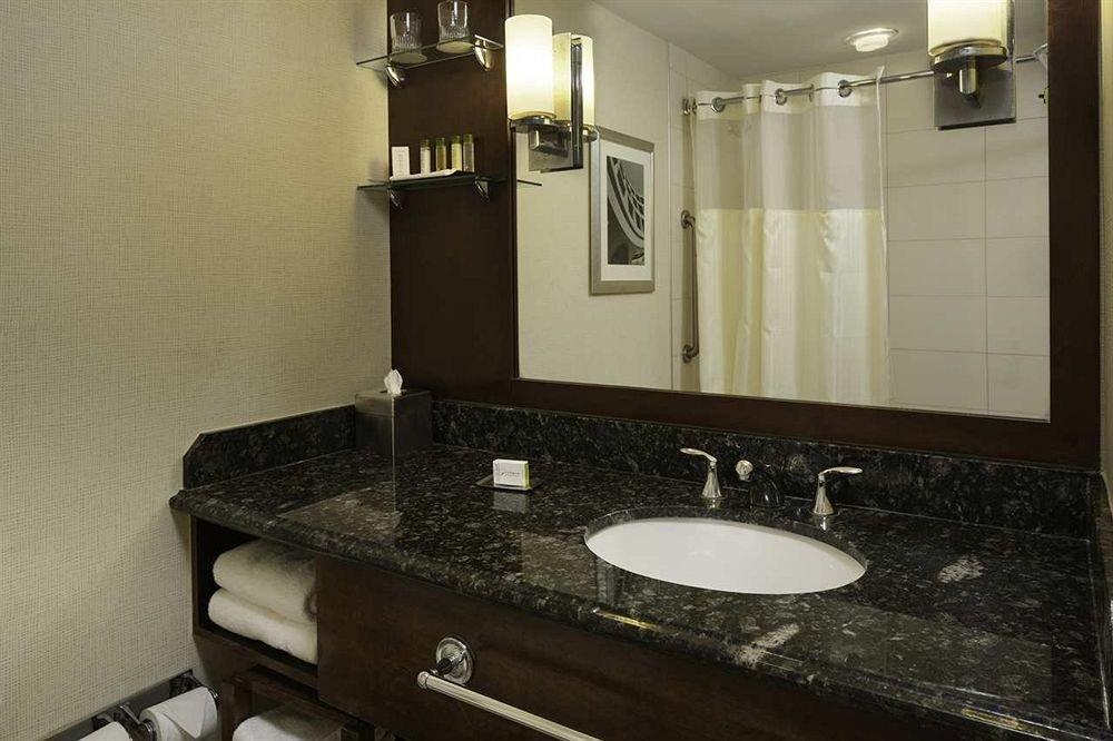 bathroom mirror sink property countertop home Kitchen plumbing fixture cabinetry toilet cottage flooring rack