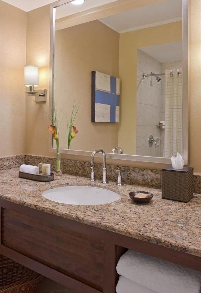 bathroom sink mirror property countertop counter home vanity plumbing fixture flooring material double cabinetry Kitchen tan