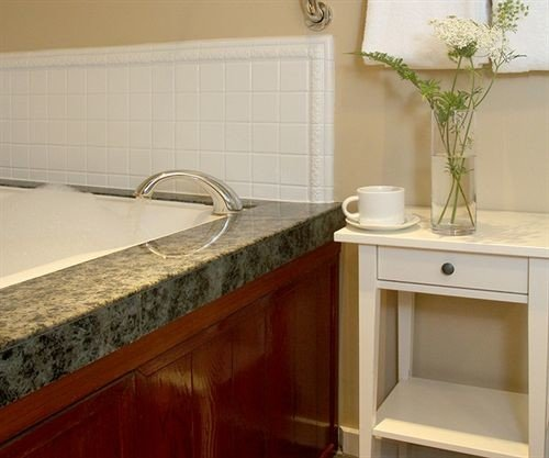 countertop bathroom sink hardwood flooring cabinetry counter Kitchen plumbing fixture tile material