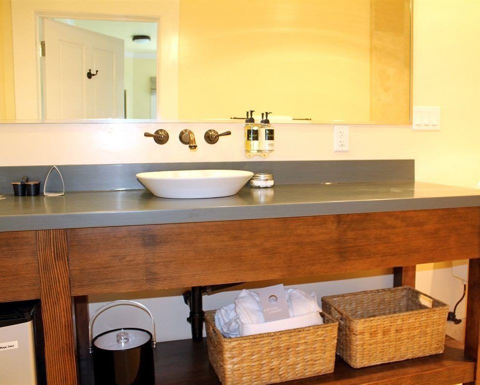 countertop property bathroom sink Kitchen cabinetry hardwood home plumbing fixture