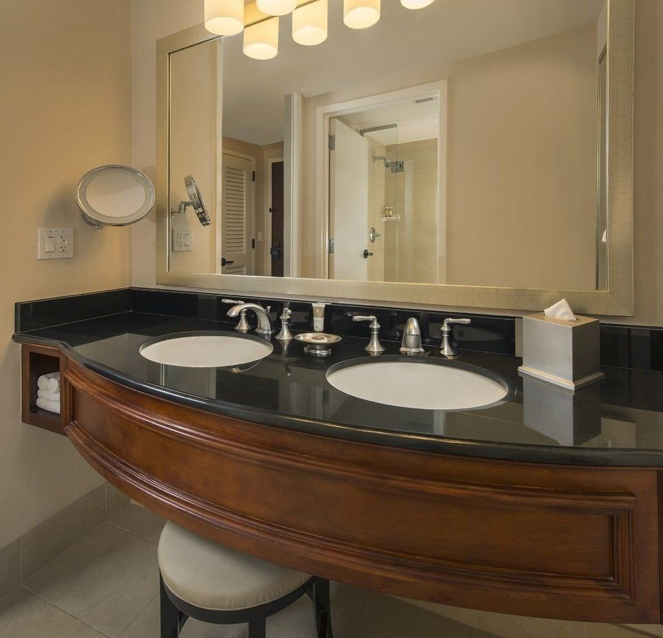 bathroom mirror sink property countertop cabinetry Kitchen hardwood home material