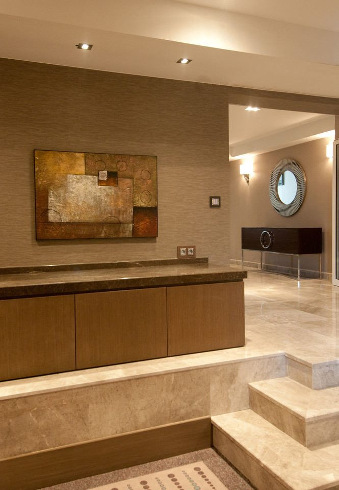 property cabinetry hardwood home countertop bathroom flooring lighting wood flooring tile Kitchen living room tan