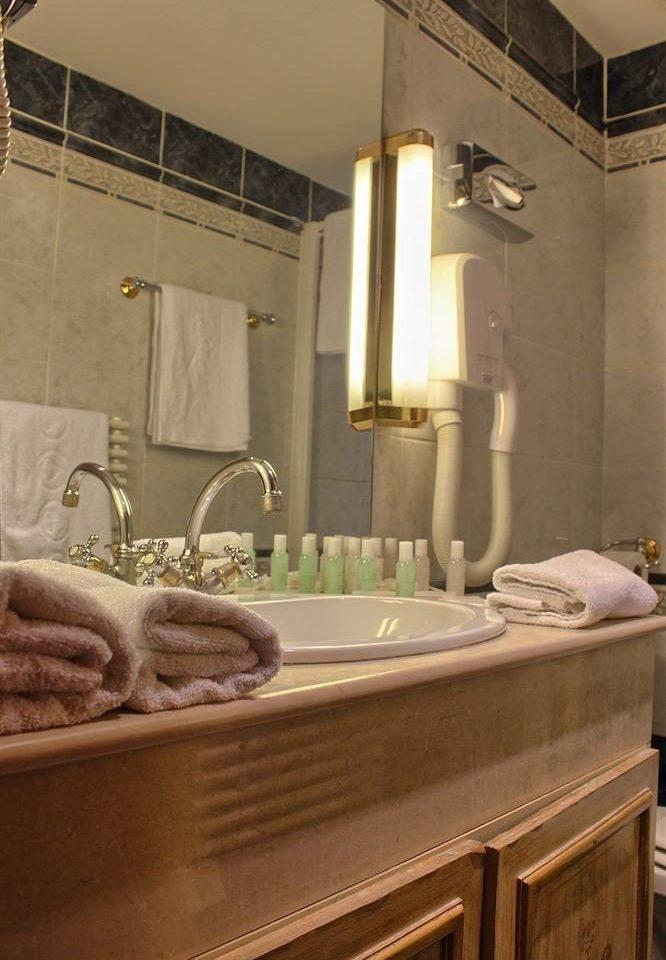 bathroom sink property countertop house home Kitchen flooring tile plumbing fixture cabinetry