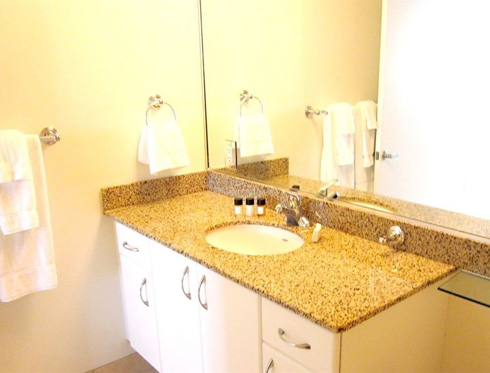 bathroom sink mirror property countertop towel Kitchen lighting counter vanity material cottage tan