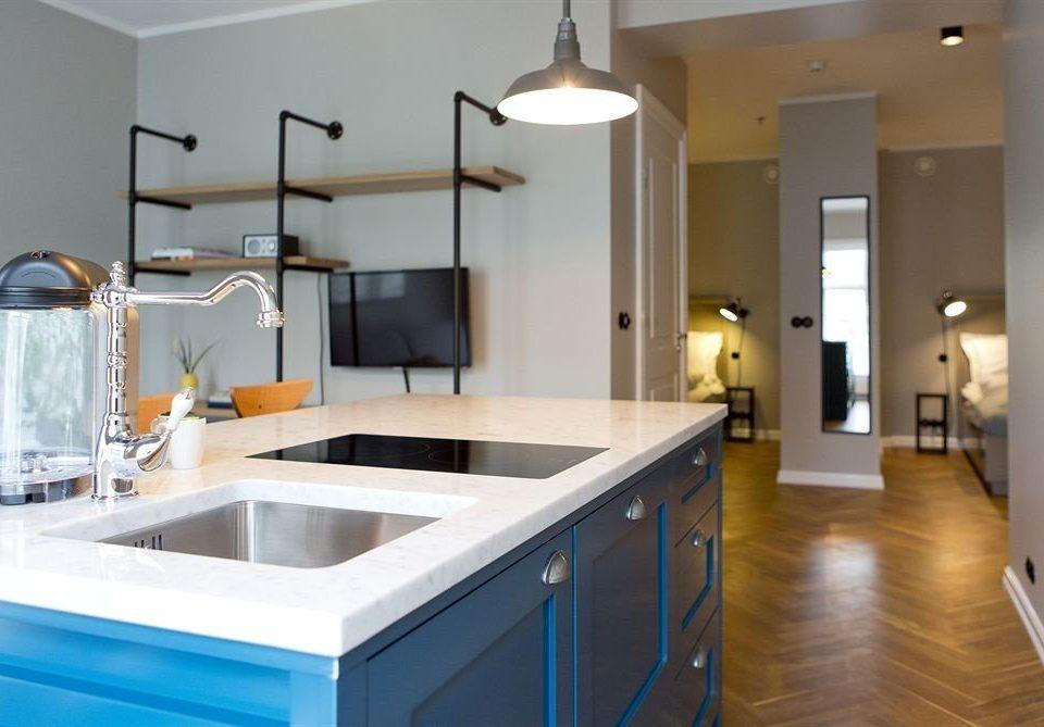 Kitchen property home countertop lighting bathroom flooring
