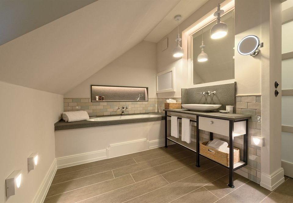 bathroom property sink hardwood home loft living room flooring daylighting wood flooring Kitchen