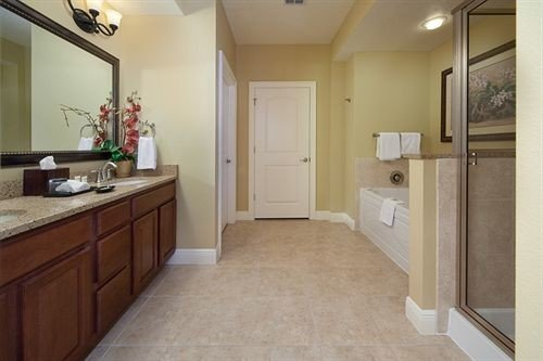 property building hardwood sink home cottage flooring cabinetry Kitchen wood flooring tan