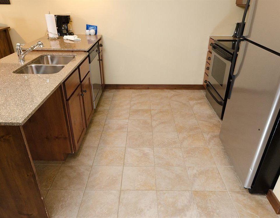 Kitchen property building flooring countertop hardwood tile wood flooring laminate flooring sink material cottage tiled