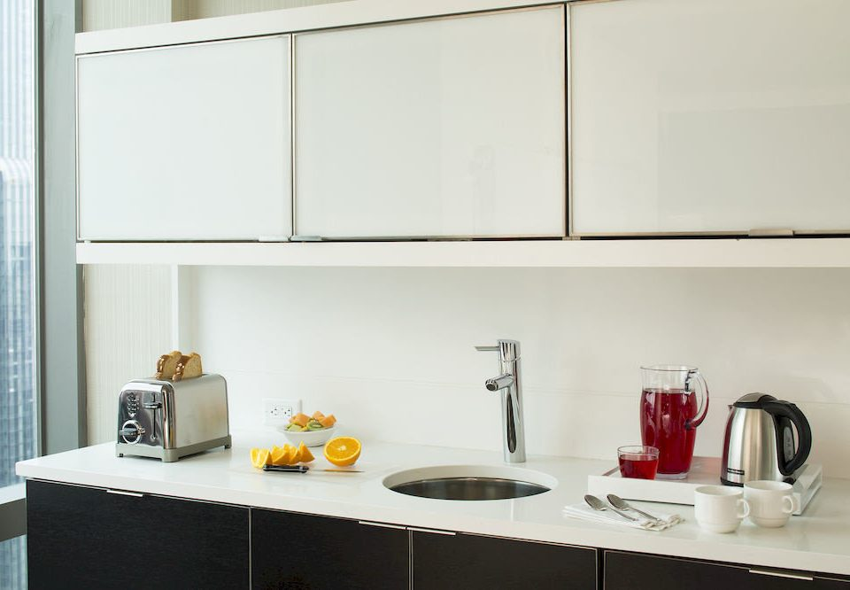 property Kitchen counter cabinetry countertop home shelf flooring cabinet kitchen appliance