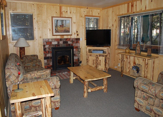 property living room home cottage log cabin hardwood cabinetry farmhouse Kitchen recreation room cluttered