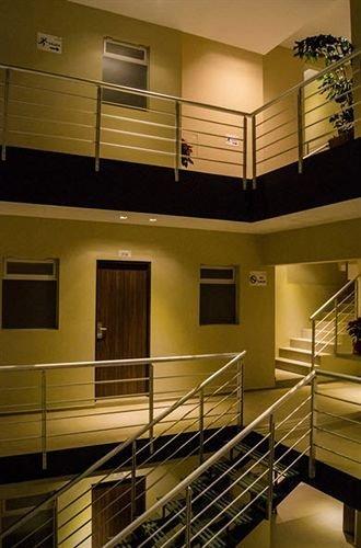 property Kitchen hardwood cabinetry home lighting wood flooring condominium living room loft countertop