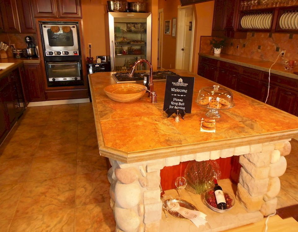property countertop cabinetry hardwood Kitchen home living room wood flooring flooring counter cottage