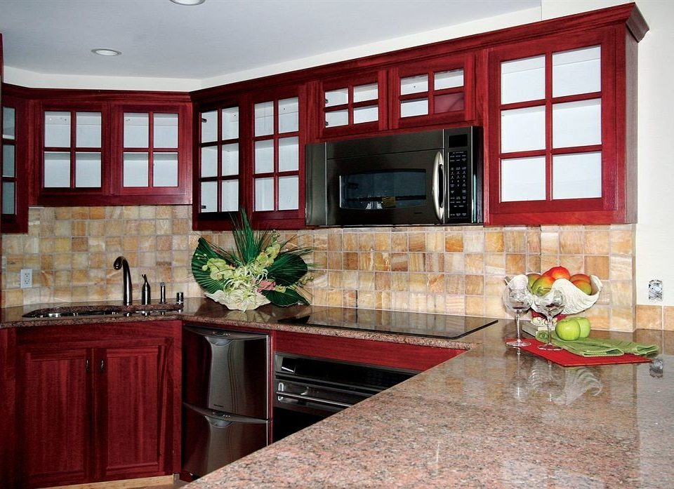 red Kitchen property cabinetry countertop home hardwood cuisine classique flooring cottage material