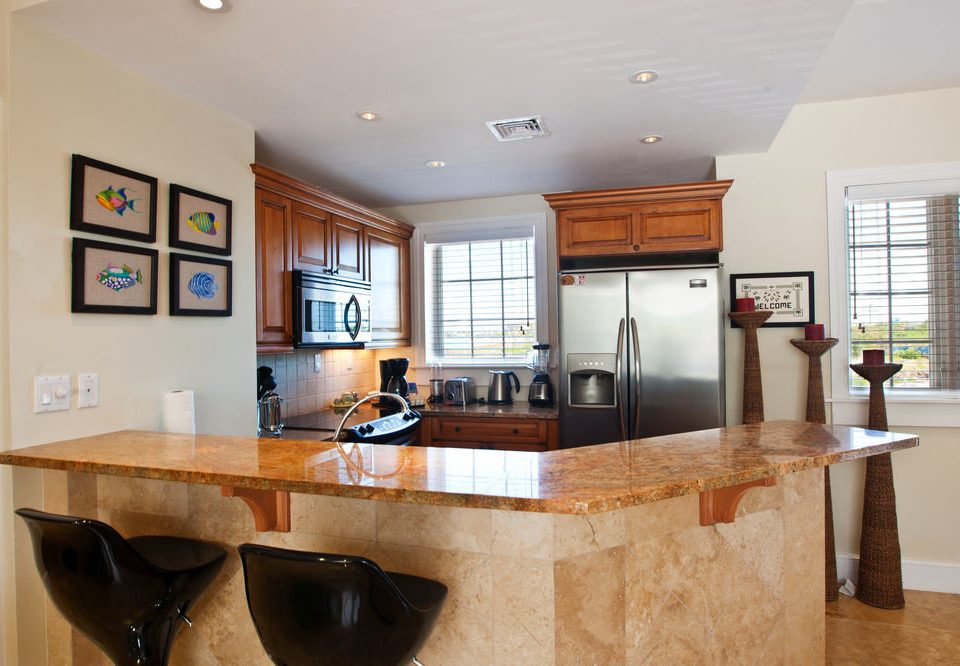property Kitchen countertop cabinetry home hardwood cuisine classique cottage living room wood flooring
