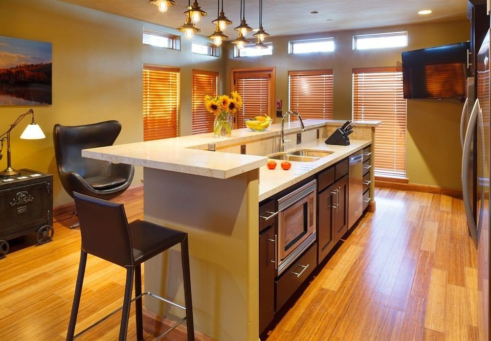 Kitchen property cabinetry home countertop hardwood cottage wood flooring hard