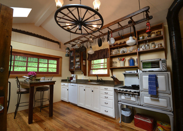 property Kitchen home cabinetry hardwood cottage shelf farmhouse recreation room