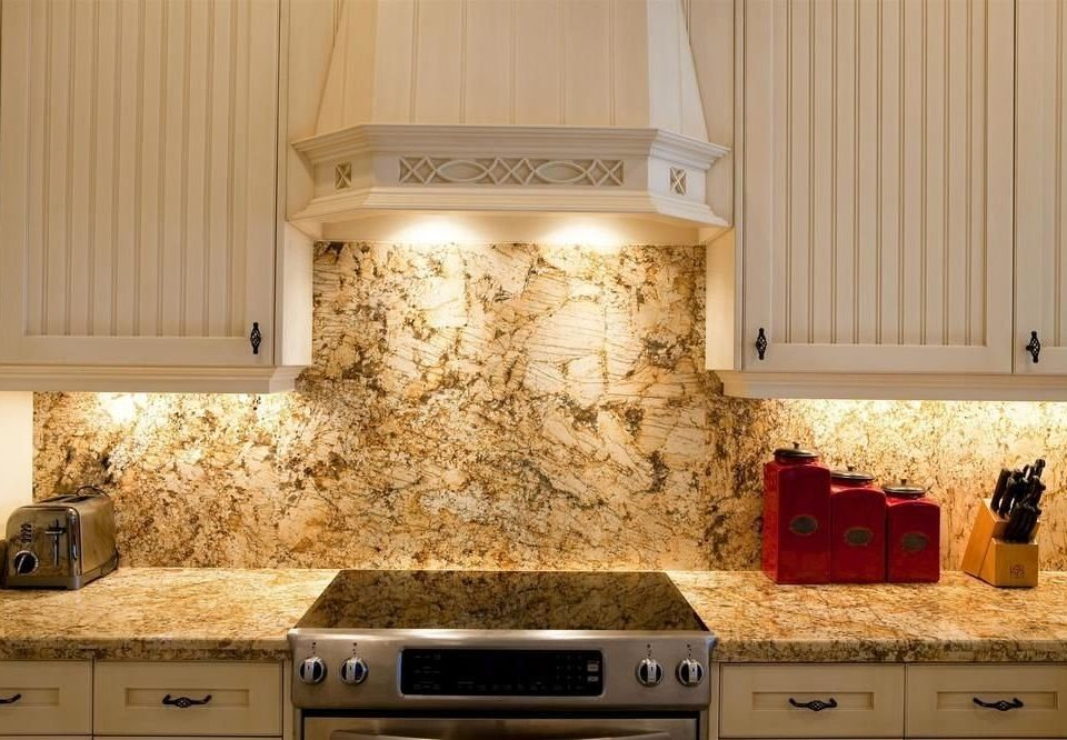 countertop Kitchen cabinetry lighting hardwood cuisine classique home material granite flooring kitchen appliance stove