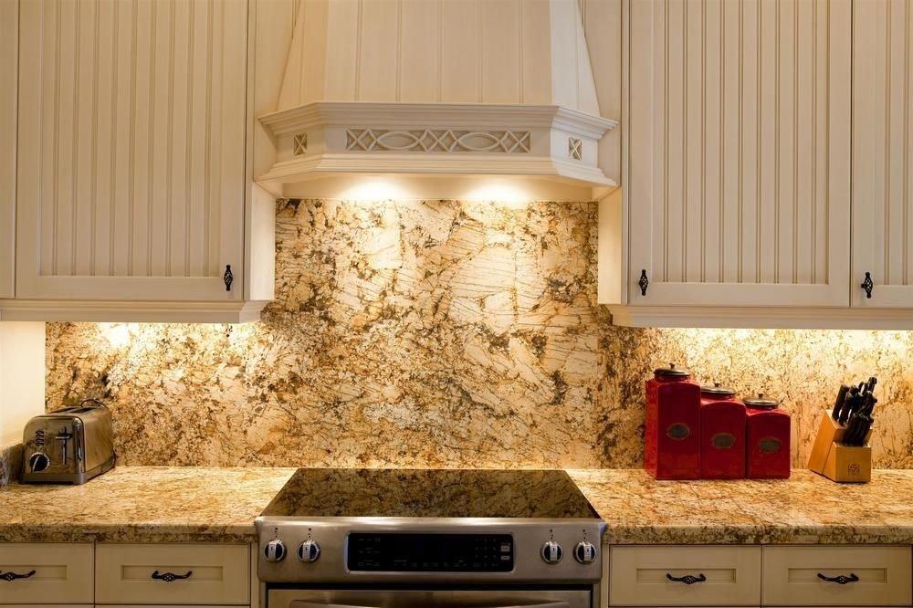 countertop Kitchen cabinetry lighting hardwood cuisine classique home material granite flooring kitchen appliance stove