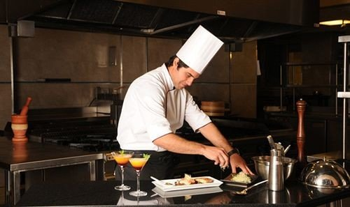 man Kitchen preparing professional cook profession chef cooking