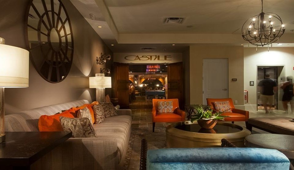 sofa property home living room cottage restaurant Kitchen orange colored