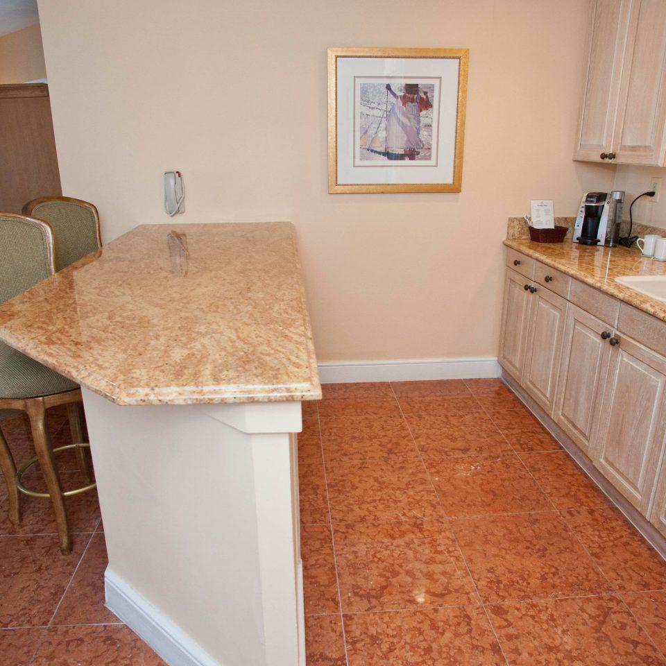 property home cottage hardwood countertop flooring Kitchen