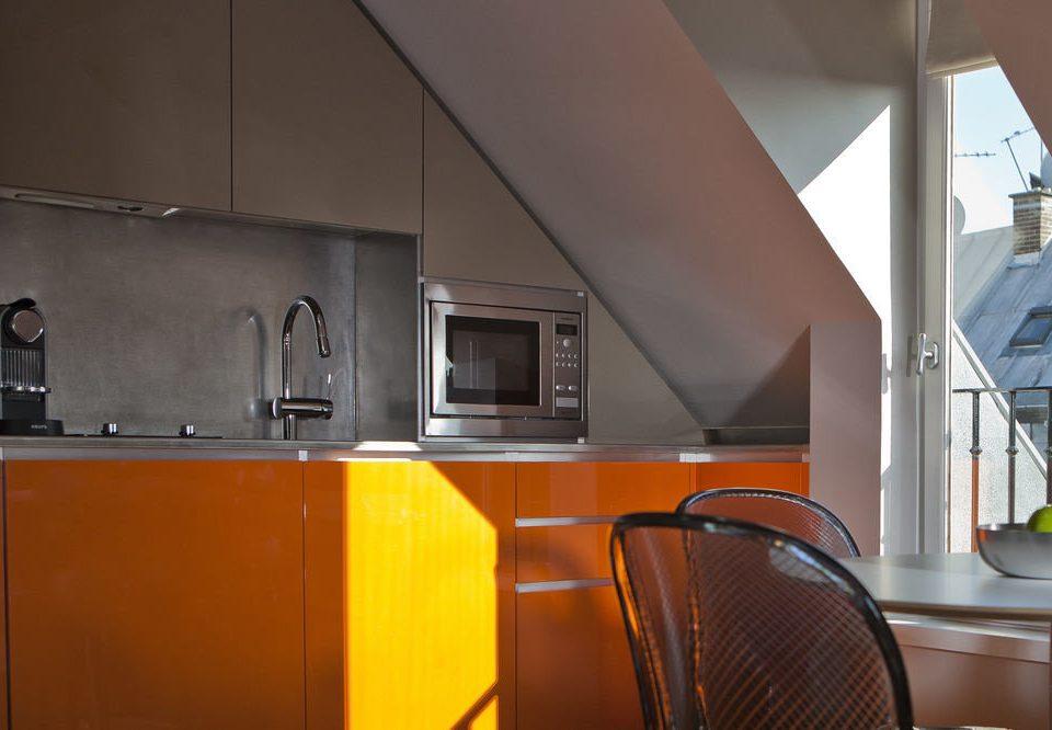 property Kitchen house orange home cottage kitchen appliance