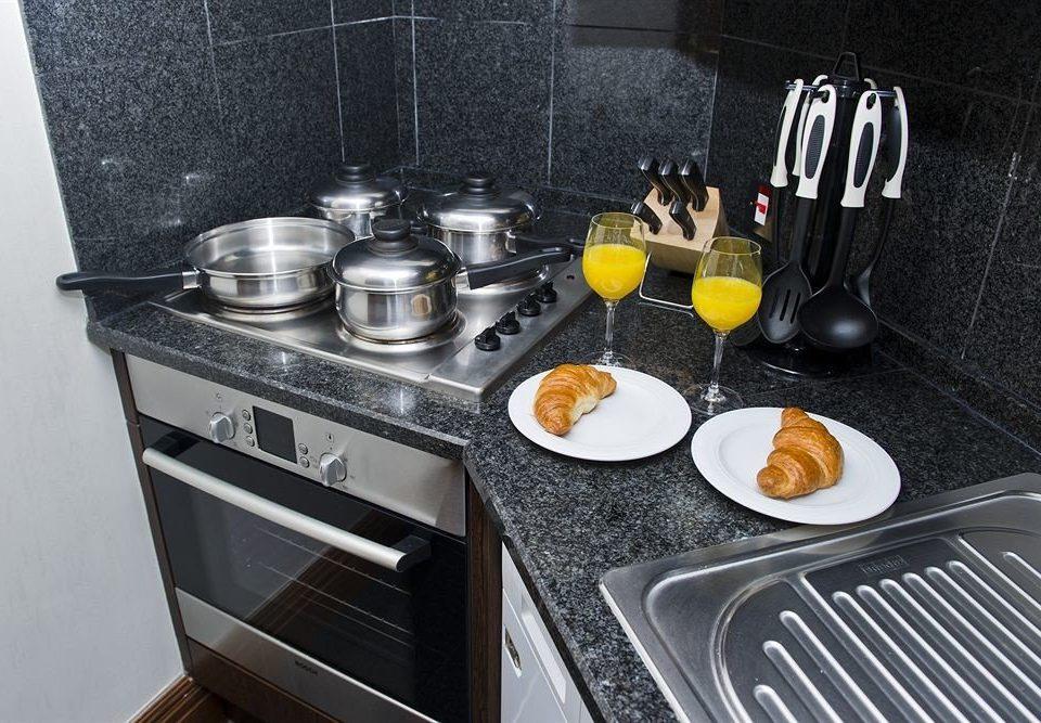 Kitchen countertop kitchenware sink kitchen stove kitchen appliance stove
