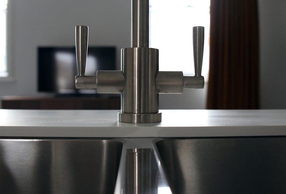 sink Kitchen plumbing fixture countertop lighting tap stainless shelf steel