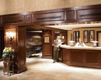 cabinet Kitchen property cabinetry hardwood home mansion yacht wood flooring Lobby flooring living room