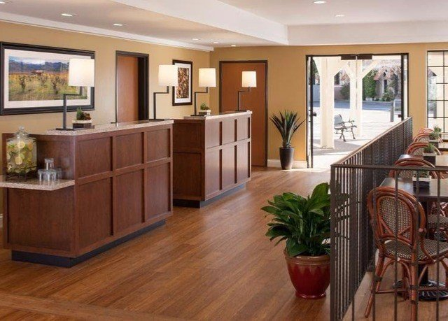 property cabinetry home hardwood Kitchen flooring wood flooring living room laminate flooring Lobby condominium hard dining table