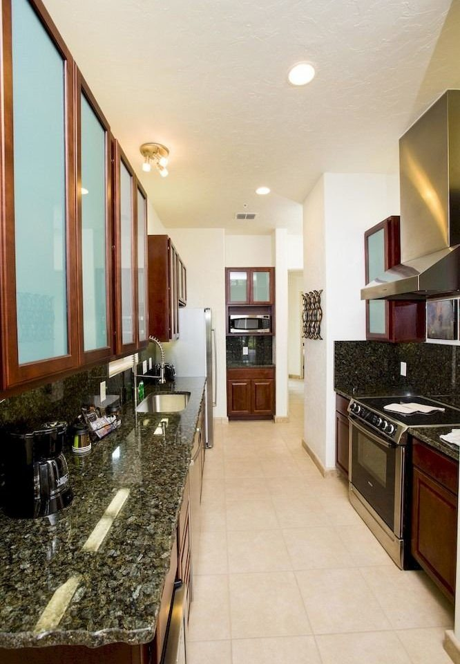 Kitchen property home hardwood Lobby condominium living room Suite flooring