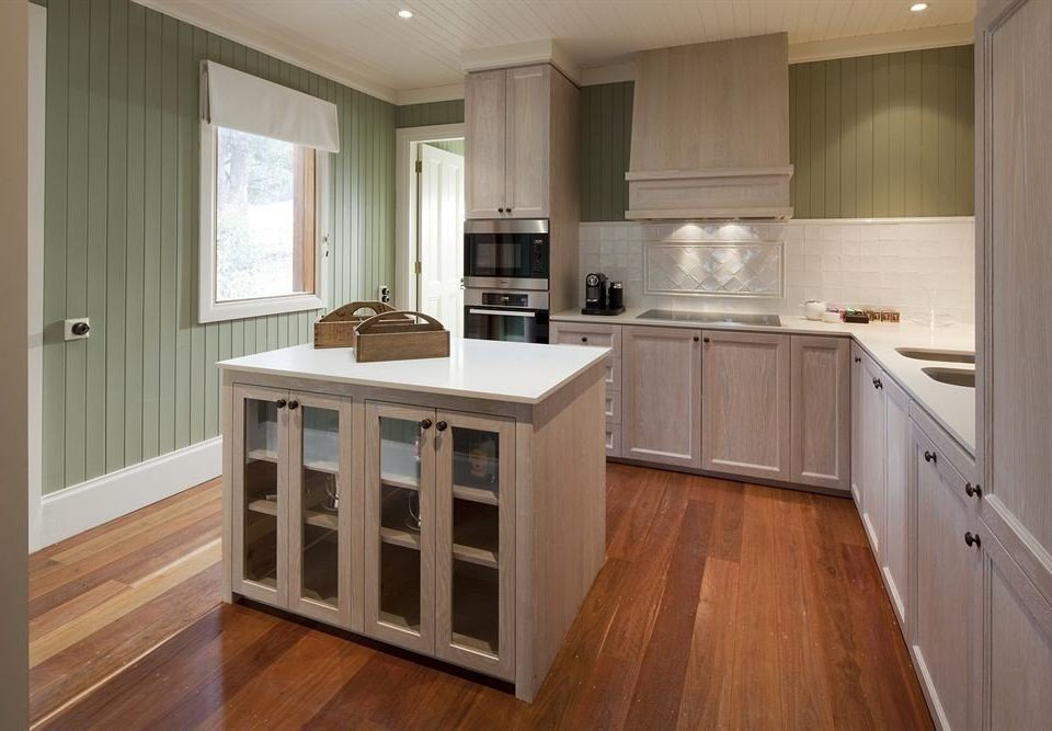 building Kitchen property cabinetry countertop hardwood home cottage cuisine classique wood flooring flooring hard laminate flooring Modern appliance