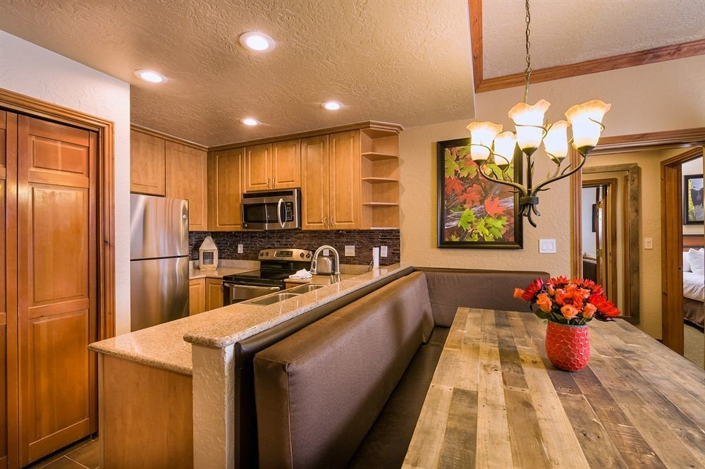 cabinet Kitchen property home cabinetry hardwood countertop cuisine classique living room wood flooring cottage stainless Modern appliance